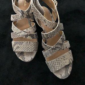 Clarks brand sandals, snakeskin look.